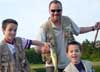 Kevin Gringas & his 2 sons show off a largemouth they caught on a fly on a pond in Bridgewater, MA