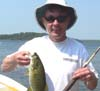 Jeff Soderholm at Long Pond with a Small Mouth he caught on an automatic Martin