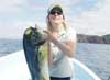 Amanda got a Dorado in Costa Rica with an Olive Clouser on a 12/12 wt